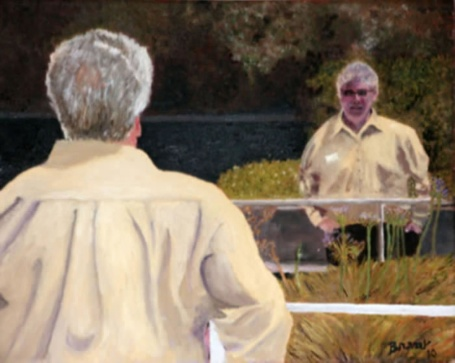 A man with his back to the viewer looks it his reflected image